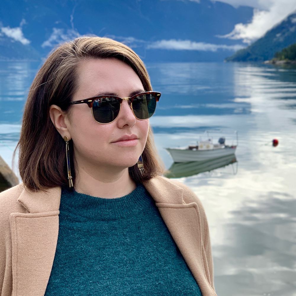 Image of Patricia O'Connor beside a fjord in Norway